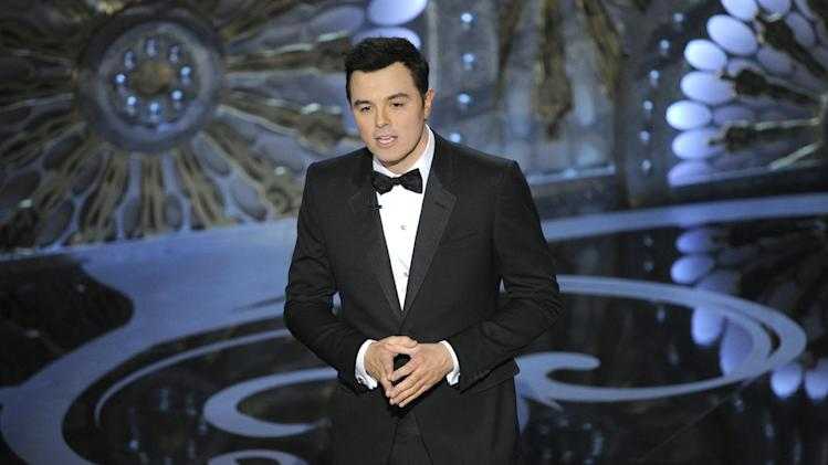 FILE - In this Feb. 24, 2013 file photo, host Seth MacFarlane speaks onstage during the Oscars at the Dolby Theatre in Los Angeles. MacFarlane is too busy to host the Oscars in 2014. He announced the news on Twitter Monday, May 20, 2013.  (Photo by Chris Pizzello/Invision/AP, File)