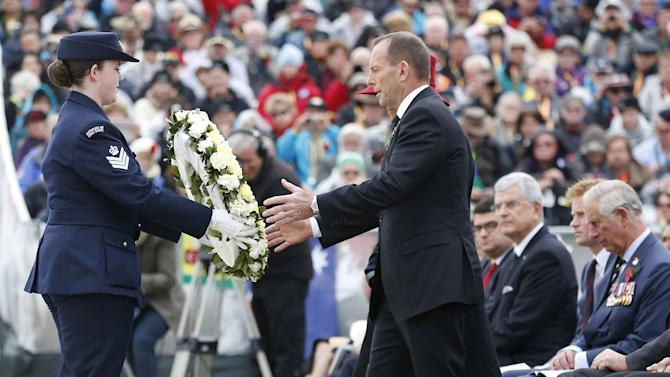 Australian Prime Minister Tony Abbott prepares to lay a wreath at the Lone Pine  memorial alongside Britain's Prince Charles and Prince Harry in Gallipoli
