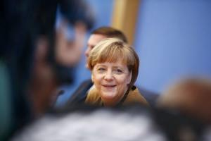 German Chancellor Merkel smiles during a news conference in Berlin
