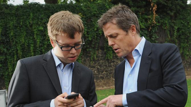 "British actor Hugh Grant, right, speaks with an unidentified 'Hacked Off' campaigner outside the Houses of Parliament in London, where a debate was being held into the allegations of phone hacking by journalists Wednesday July 6, 2011. Britain's voracious tabloids may have hit a new low: The News of the World, part of Rupert Murdoch's global media empire at News Corp, is facing claims that it hacked into a missing 13-year-old's phone messages, possibly hampering a police inquiry into her disappearance.  ""Newspapers were using phone hacking on a widespread and industrial basis ... (with) the apparent collusion of parts of the Metropolitan Police,"" actor Hugh Grant told BBC radio.  (AP Photo/Stefan Rousseau/PA Wire)  UNITED KINGDOM OUT"