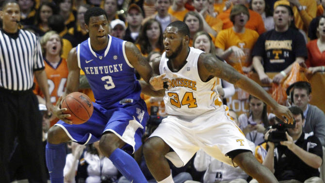 Kentucky's Terrence Jones (3) works against Tennessee's Jeronne Maymon (34) in the first half of an NCAA college basketball game on Saturday, Jan. 14, 2012, in Knoxville, Tenn. Kentucky won 65-62. (AP Photo/Wade Payne)