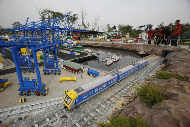 File picture shows a Lego train passing through a model of Malaysia's Tanjung Pelepas shipyard during a media preview of Legoland Malaysia at Nusajaya in the southern state of Johor