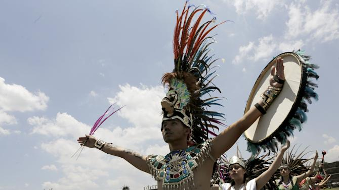 Dancers dressed in prehispanic costumes perform during the Ceremony of the Ignition of the New Fire, at the ancient pyramids of Teotihuacan outside Mexico City