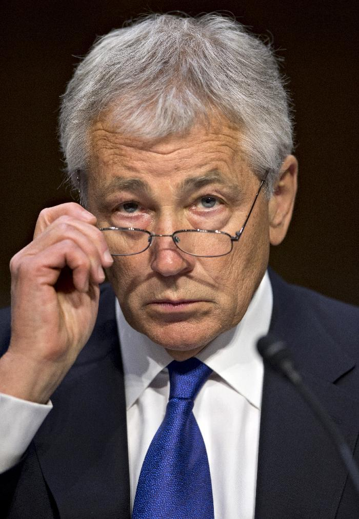 Defense Secretary Chuck Hagel testifies on Capitol Hill in Washington, Wednesday, April 17, 2103, before the Senate Armed Services Committee hearing on the Pentagon's budget for fiscal 2014 and beyond. (AP Photo/J. Scott Applewhite)