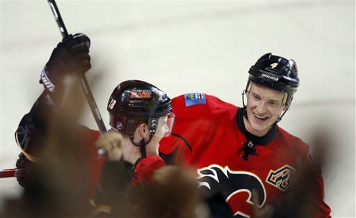 Stajan scores in OT, lifts Flames over Sharks