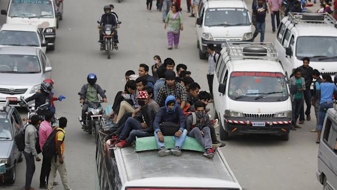 People leave for safer places after Saturday's earthquake, in Kathmandu