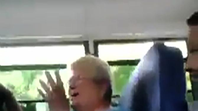 In this cellphone video image taken from YouTube via AP video, bus monitor Karen Klein reacts to several seventh-grade students mercilessly taunting her on a bus, Monday, June 18, 2012, in Greece, N.Y. Since the video has gone viral, small donations for Klein from around the world have poured into the crowd-funding site indiegogo.com, at one point crashing the site and pulling in a staggering $443,057 by early Friday, June 22, 2012. (AP Photo/YouTube via AP video)