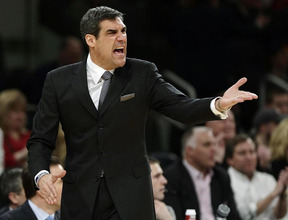 Villanova head coach Jay Wright calls out to a referee during the first half of an NCAA college basketball game against Louisville at the Big East Conference tournament, Thursday, March 14, 2013, in New York. (AP Photo/Frank Franklin II)