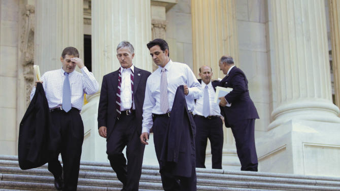 """Rep. Jim Jordan, R-Ohio, the Republican Study Committee chairman, far left, leaves the Capitol with fellow House GOP members after passage of the conservative deficit reduction plan known as """"Cut, Cap and Balance"""" that prevailed 234-190, in Washington, Tuesday, July 19, 2011.  (AP Photo/J. Scott Applewhite)"""