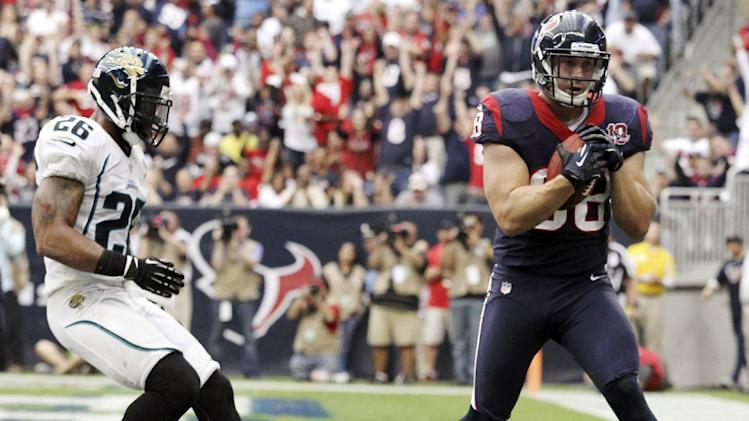 Houston Texans tight end Garrett Graham (88) scores a touchdown ahead of Jacksonville Jaguars' Dawan Landry (26) during the fourth quarter of an NFL football game, Sunday, Nov. 18, 2012, in Houston. (AP Photo/Patric Schneider)