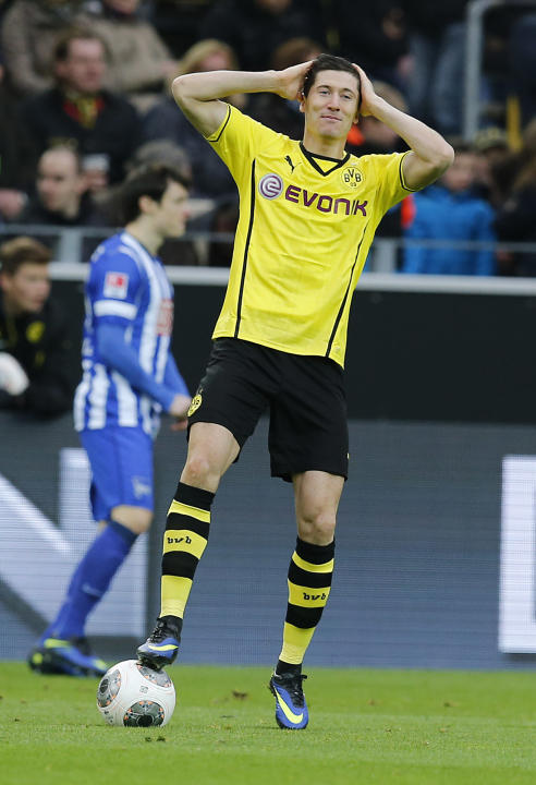 Dortmund's Robert Lewandowski of Poland holds his head during the German first division Bundesliga soccer match between Borussia Dortmund and Hertha BSC Berlin in Dortmund, Germany, Saturday, Dec.