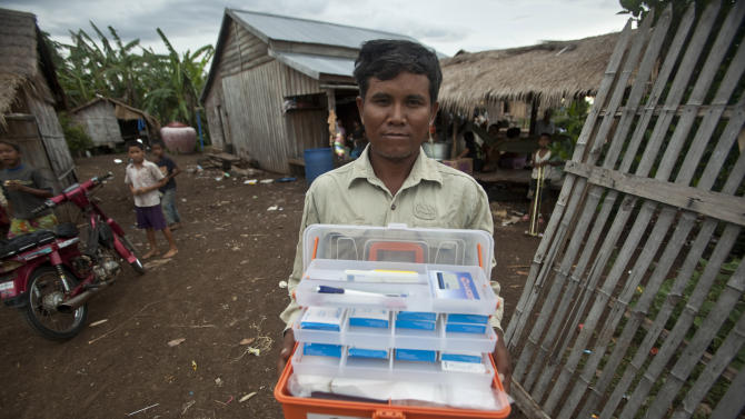 FILE - This Aug. 29, 2009 photo shows village malaria worker Phoun Sokha, 47, showing his malaria medicine kit at O'treng village on the outskirts of Pailin, Cambodia. This spot on the Thai-Cambodian border is home to a form of malaria that keeps rendering one powerful drug after another useless. This time, scientists have confirmed the first signs of resistance to the only affordable treatment left in the global medicine cabinet for malaria: Artemisinin. U.S. experts are raising the alarm over the spread of drug-resistant malaria in several Southeast Asian countries, endangering major global gains in fighting the mosquito-borne disease that kills more than 600,000 people annually. The report warns that could be a health catastrophe in the making, as no alternative anti-malarial drug is on the horizon. (AP Photo/David Longstreath, File)