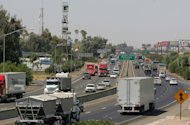 FILE - In this Aug. 23, 2011 file photo, a stretch of the Calif. State Route 99 corridor in the San Joaquin Valley is shown busy with traffic in Fresno, Calif. CThe United Nations climate chief is urging people not to look solely to their governments to make tough decisions to slow global warming, and instead to consider their own role in solving the problem. Approaching the half-way point of two-week climate talks in Doha, Christiana Figueres, the head of the U.N.&#39;s climate change secretariat, said Friday, Nov. 30, 2012 that she didn&#39;t see &quot;much public interest, support, for governments to take on more ambitious and more courageous decisions.&quot;(AP Photo/Gary Kazanjian, File)