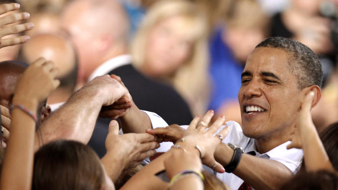 President Barack Obama shakes hands with supporters during a campaign stop in Windham, N.H., Saturday, Aug. 18, 2012.  (AP Photo/Winslow Townson)