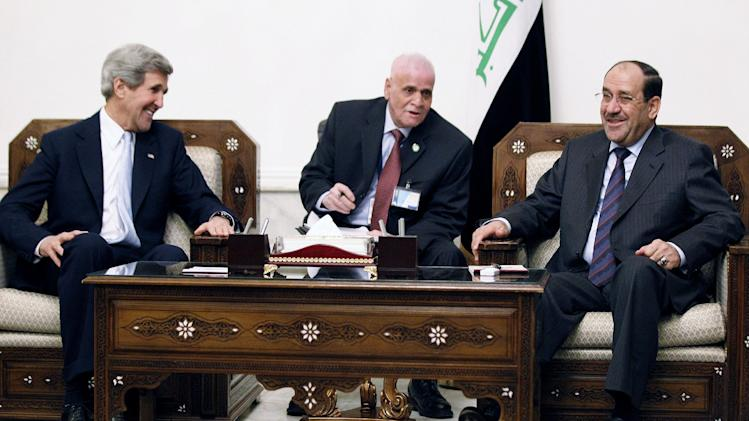 U.S. Secretary of State John Kerry, left, meets with Iraq's Prime Minister Nouri al-Maliki, right, in Baghdad, Iraq, Sunday, March 24, 2013. Kerry made an unannounced visit to Iraq on Sunday and will urge al-Maliki to make sure Iranian flights over Iraq do not carry arms and fighters to Syria, a U.S. official said.  (AP Photo/Jason Reed, Pool)