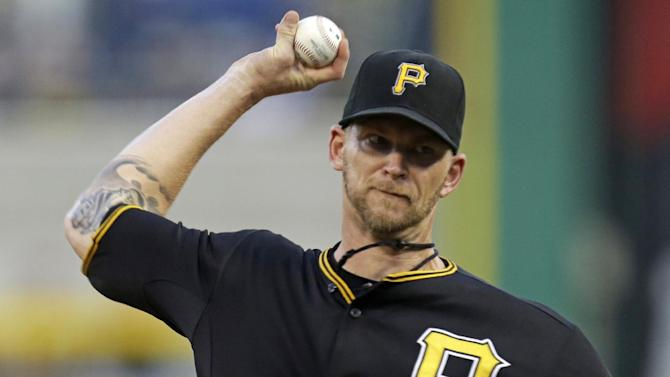 Pittsburgh Pirates starting pitcher A.J. Burnett (34) delivers during the first inning of a baseball game against the St. Louis Cardinals in Pittsburgh Saturday, Aug. 31, 2013. (AP Photo/Gene J. Puskar)