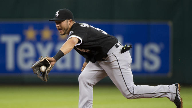 Chicago White Sox second baseman Carlos Sanchez stretches to pull in a ball hit by Houston Astros' Luis Valbuena, starting a double play in the second inning of a baseball game Friday, May 29, 2015, in Houston. (AP Photo/George Bridges)