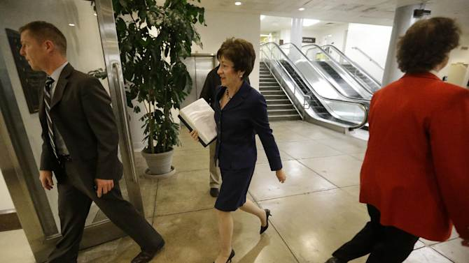 """Sen. Susan M. Collins, R-Maine, ranking Republican on the Homeland Security and Governmental Affairs Committee, arrives for a closed briefing on Capitol Hill in Washington, Wednesday, Nov. 14, 2012. Earlier,  Collins said it was """"absolutely imperative"""" that former CIA Director David Petraeus testify, since he was CIA director during the attack and visited Libya afterward. (AP Photo/Pablo Martinez Monsivais)"""