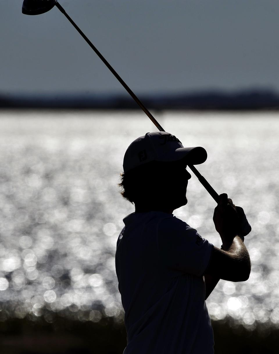 RETRANSMISSION FOR ALTERNATE CROP - Webb Simpson watches his drive off the 14th tee during the second round of the McGladrey Classic golf tournament at the Sea Island Golf Club on St. Simons Island, Ga., Friday, Oct. 14, 2011. (AP Photo/Stephen Morton)