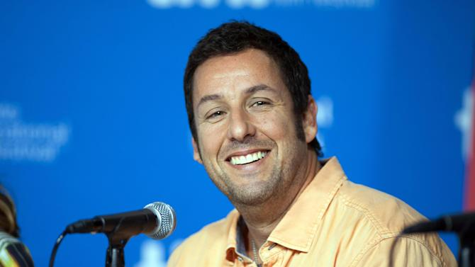 "FILE - In this Sept. 6, 2014 file photo, actor Adam Sandler smiles during a news conference for ""Men, Women, and Children"" at the 2014 Toronto International Film Festival in Toronto. Sandler will star in ""The Ridiculous Six"", which premieres on Dec. 11 on Netflix. The movie is one of four he will star in and produce for Netflix.  (Hannah Yoon/The Canadian Press via AP, File)   MANDATORY CREDIT"