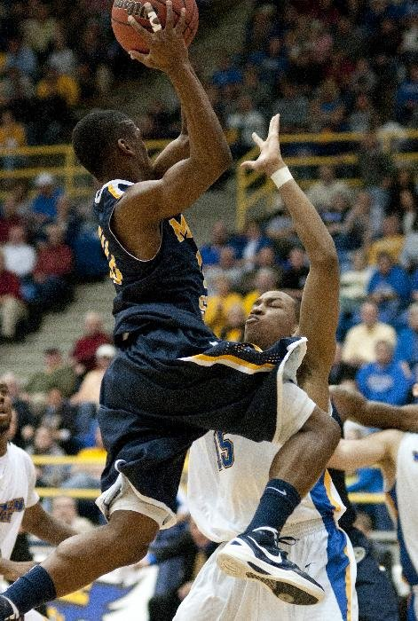 Morehead State's Jordan Percell, right, takes a charge from Murray State's Jewuan Long during an NCAA college basketball game Wednesday Jan. 18, 2012, in Morehead, Ky. Murray State remains undefeated