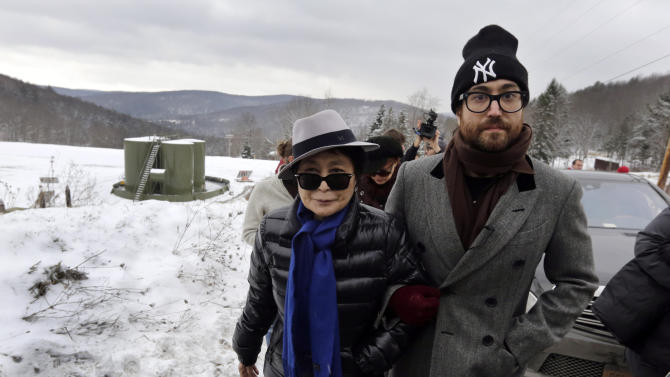 """FILE - In this file photo of Jan. 17, 2013, Yoko Ono, left, and her son Sean Lennon visit a fracking site in Franklin Forks, Pa., during a bus tour of natural-gas drilling sites in northeastern Pennsylvania. Ono and Lennon have formed a group called """"Artists Against Fracking,"""" which has become the main celebrity driven anti-fracking organization.  (AP Photo/Richard Drew, File)"""