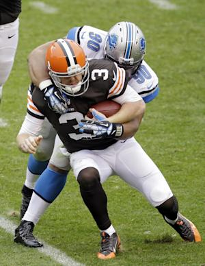 Detroit Lions defensive tackle Ndamukong Suh (90) sacks Cleveland Browns quarterback Brandon Weeden (3) in the third quarter of an NFL football game Sunday, Oct. 13, 2013, in Cleveland. (AP Photo/Tony Dejak)