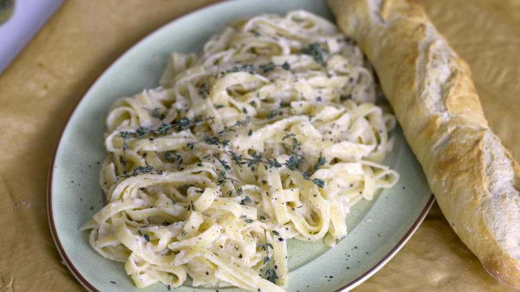 This Jan. 27, 2014 photo show fettuccini with garlic parmesan puree in Concord, N.H. (AP Photo/Matthew Mead)