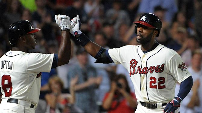 Heyward's homer helps Braves sweep Cardinals, 5-2
