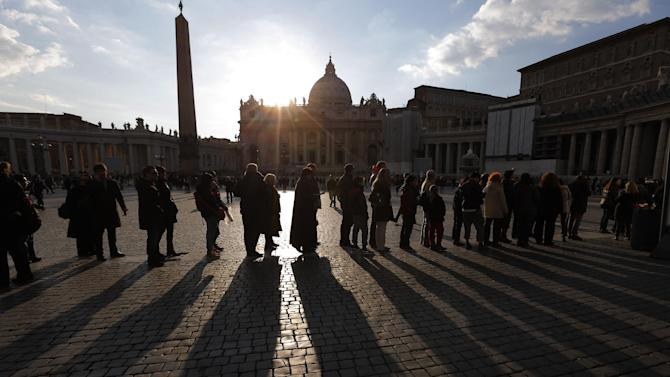 "People stand in a line in St. Peter's Square to enter the St. Peter's Basilica  at the Vatican, Saturday, March 16, 2013. Pope Francis offered intimate insights Saturday into the moments after his election, telling journalists that he was immediately inspired to take the name of St. Francis of Assisi because of his work for peace and the poor — and that he himself would like to see ""a poor church and a church for the poor."" (AP Photo/Dmitry Lovetsky)"