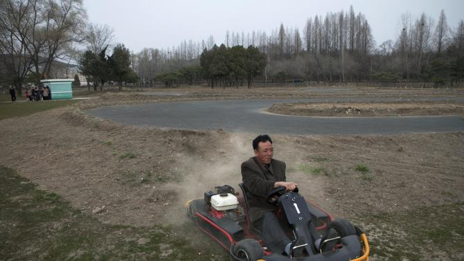 AP10ThingsToSee - A North Korean man misses the turn and loses control of his go cart on a track at the Fun Fair in Pyongyang on Tuesday, April 16, 2013. (AP Photo/David Guttenfelder, File)
