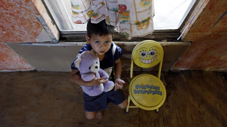 Yareth Lopez, 3, sits with a teddy bear at his family's home, Thursday, Sept. 6, 2012, in Alamo, Texas. Lopez was born in the United States, but his mother and grandmother who he lives with are illegal immigrants. When healthcare reform has been fully implemented, illegal immigrants will make up the nation's second-largest population of uninsured, or about 25 percent. The only larger group will be people who qualify for insurance but fail to enroll, according to a 2012 study by the Washington-based Urban Institute. (AP Photo/Eric Gay)