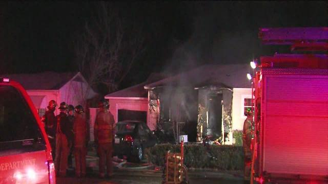Three escape North Tulsa house fire