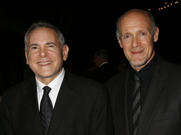 FILE - This Nov. 15, 2007 file photo shows Craig Zadan, left, and Neil Meron, producers of the film &quot;Hairspray&quot; at the Santa Barbara International Film Festival&#39;s in Santa Barbara, Calif. Academy Awards producers Zadan and Meron announced Monday, Feb. 11, 2013, that Renee Zellweger, Catherine Zeta Jones, Queen Latifah and Richard Gere will return to the stage where Chicago won best picture in 2003. Zadan and Meron also produced the film. The 85th annual Academy Awards will be presented Feb. 24, 2013, at the Dolby Theatre and broadcast live on ABC. (AP Photo/Michael A. Mariant, File)