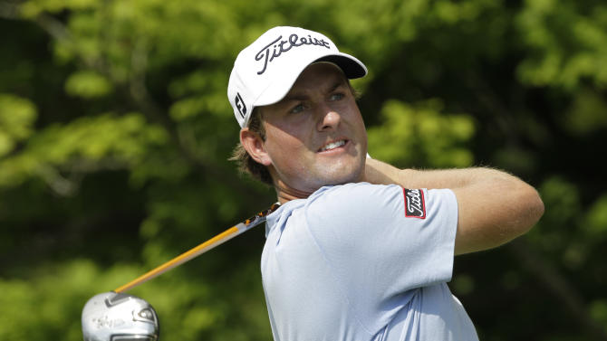 Webb Simpson watches his tee shot on the 17th hole during the first round of the Greenbrier Classic PGA Golf tournament at the Greenbrier in White Sulphur Springs, W. Va., Thursday, July 5, 2012.  (AP Photo/Steve Helber)