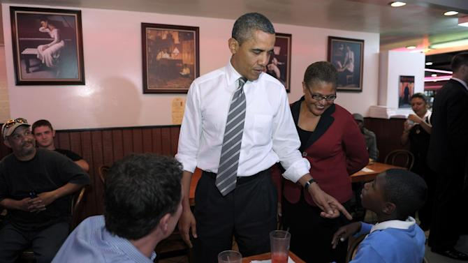 President Barack Obama stops for a snack at Roscoe's House of Chicken and Waffles in Los Angeles, Monday, Oct. 24, 2011. Obama, who was joined by Rep. Karen Bass, D-Calif., is on a three-day trip to the West Coast. (AP Photo/Susan Walsh)