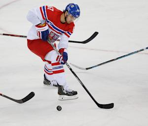 Czech Republic forward Michael Frolik navigates between …