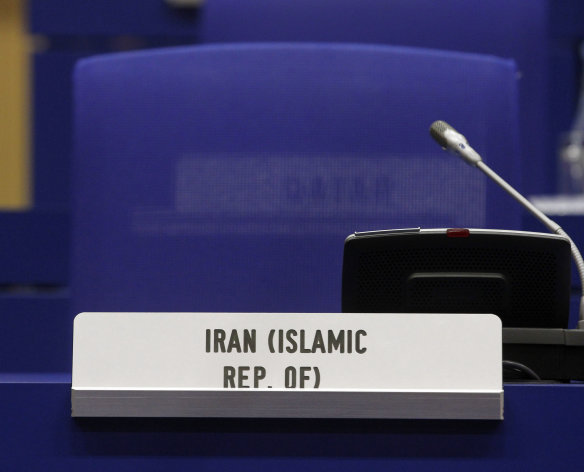 The armchair of Iran's Ambassador to the International Atomic Energy Agency, IAEA, Ali Asghar Soltanieh remains empty at the start of the IAEA board of governors meeting at the International Center, in Vienna, Austria, on Tuesday, March 6, 2012. (AP Photo/Ronald Zak)