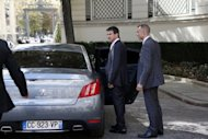 <p>French Interior Minister Manuel Valls gets into a Peugeot car as he leaves his ministry on August 30. A new study on Peugeot Citroean was commissioned by the new Socialist government against the background of a plan by the group, the second-biggest automaker in Europe after the VW group, to shed 8,000 jobs in France</p>