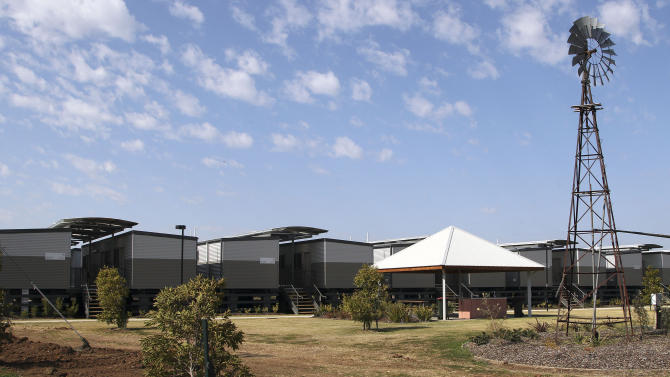 This Sept. 11, 2012 photo shows temporary accommodations being built to house workers for a coal mining boom in Narrabri, Australia, near Gunnedah, 450 kilometers (280 miles) northwest of Sydney. Shenhua Watermark, a subsidiary of state-owned China Shenhua Energy, the world's biggest coal mining company, spent 167 million Australian dollars (more than $170 million) to buy 43 farms covering 36,300 acres in the area. Gunnedah's former mayor says sellers told him Shenhua paid several times market value. (AP Photo/Rob Griffith)