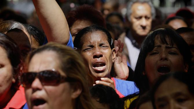 """Women react as they gather at Simon Bolivar square in support of Venezuela's President Hugo Chavez in Caracas, Venezuela, Sunday Dec.  9, 2012.  Chavez is to return to Cuba Sunday for another surgery in his battle against cancer, which has led him to speak publicly of a successor for the first time.  Chavez said Saturday that if there are """"circumstances that prevent me from exercising the presidency further""""  Vice-President Nicolas Maduro should replace him for the remainder of his term.(AP Photo/Fernando Llano)"""