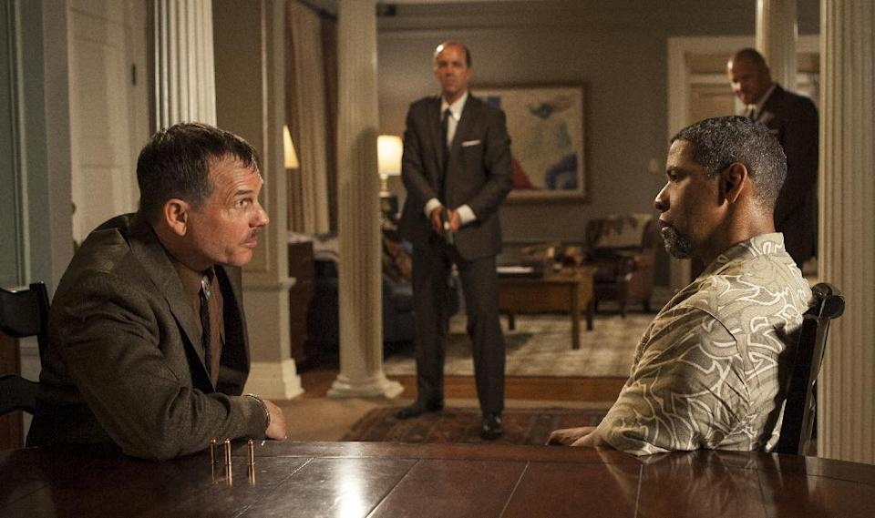 "This image released by Universal Pictures shows Bill Paxton, left, and Denzel Washington in a scene from ""2 Guns."" (AP Photo/Universal Pictures, Patti Perret)"