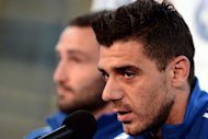 Greece's midfielder Konstantinos Katsouranis speaks during a press conference at the Municipal stadium of Legionowo. Greece will face Germany at the quarter-finals of the Euro 2012 football championships