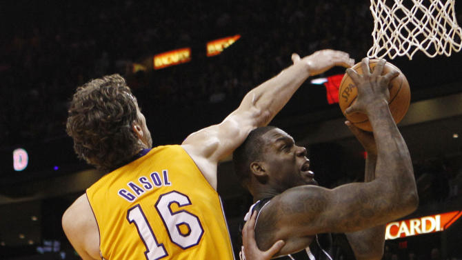 Miami Heat's Eddy Curry (34) attempts a shot as Los Angeles Lakers' Pau Gasol (16) defends during the first half of an NBA basketball game on Thursday, Jan. 19, 2012, in Miami. (AP Photo/Lynne Sladky)