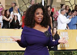 """Actress Oprah Winfrey from the film """"The Butler"""" arrives at the 20th annual Screen Actors Guild Awards in Los Angeles"""