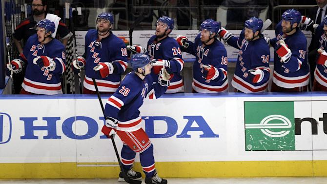 New York Rangers' Chris Kreider, front, skates by teammates after scoring a goal against the New Jersey Devils during the third period of Game 1 of their NHL hockey Stanley Cup Eastern Conference final playoff series, Monday, May 14, 2012, at New York's Madison Square Garden. (AP Photo/Julio Cortez)