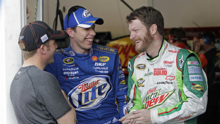 Driver's, from left, Jamie McMurray, Brad Keselowski and Dale Earnhardt Jr. share a laugh in the garage during a practice session for Sunday's NASCAR Daytona 500 auto race in Daytona Beach, Fla., Wednesday, Feb. 22, 2012. (AP Photo/John Raoux)