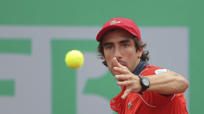 Pablo Cuevas of Uruguay plays a semi-final tennis match against Gregor Dimitrov of Bulgaria during the Istanbul Open tennis tournament at Garanti Koza Arena in Istanbul, Turkey, Saturday, May 2, 2015. Cuevas won the match and will play at the final on Sunday, May 3, 2015, against Roger Federer of Switzerland. The first ever ATP World Tour event in Turkey is being played on clay from April 27, to May 3, 2015. (AP Photo)