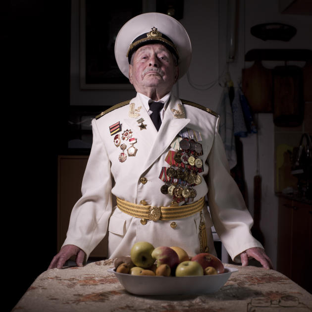 In this photo made on Thursday, April 11, 2013, Soviet Jewish World War Two veteran Yaakov Vilkovich, 90, poses for a portrait at his house in the southern Israeli city of Ashdod. Vilkovich  joined th