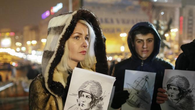 People hold pictures of Ukrainian army pilot Savchenko as they take part in a rally demanding her liberation by Russia, at Independence Square in central Kiev